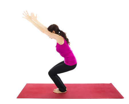 Woman doing Chair pose during Yoga  Series with the same model available