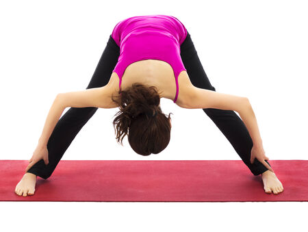strengthening: Woman doing a variation of wide legged forward bend in yoga  Series with the same model available