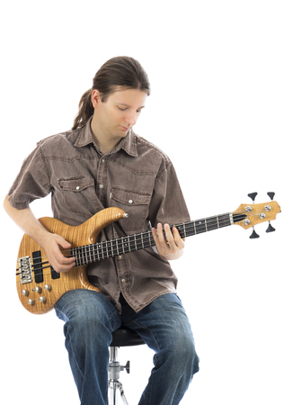 bassist: Bass guitarist playing his bass guitar  Series with the same model available