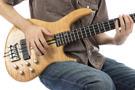 bassist: Bass guitarist with his bass guitar  Series with the same model available