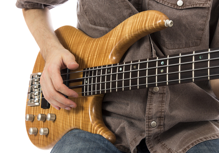bassist: Bass guitar, close-up  Series with the same model available  Stock Photo
