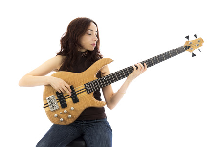 Young woman playing a bass guitar  Series with the same model available