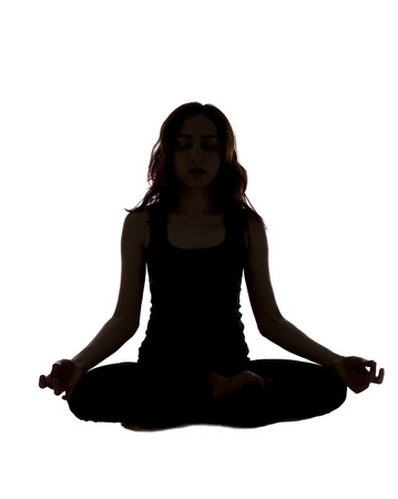 Woman is meditating in seated position. photo