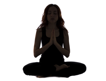 Young woman is in namaste pose meditating. photo