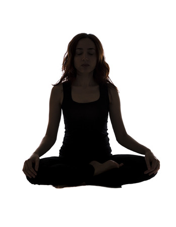 Young woman is in seated position during yoga. photo