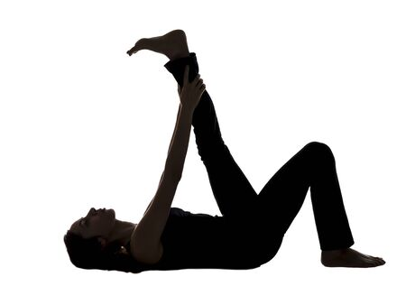 Young woman is doing Reclining Leg Stretching in Yoga.