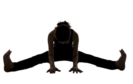 Young woman is doing forward bening in Yoga.
