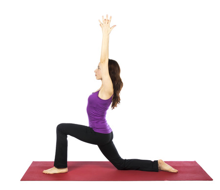 Young woman is doing a High Lunge Variation in Yoga.