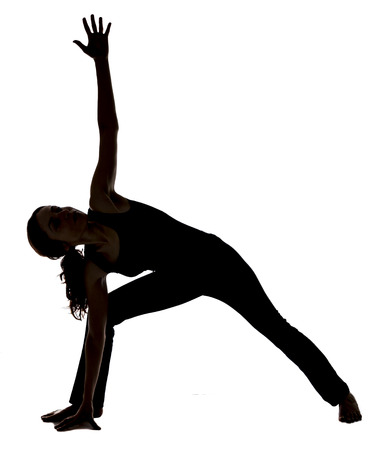 parsvakonasana: Young woman is doing Extended Side Angle Pose in Yoga.