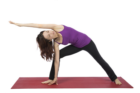 30 34 years: Woman doing extended side angle pose in yoga