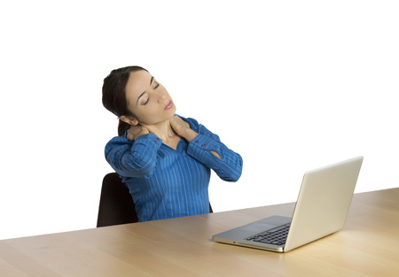 working stiff: Young business woman is massaging her neck.