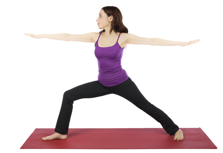 Woman is doing warrior pose in yoga