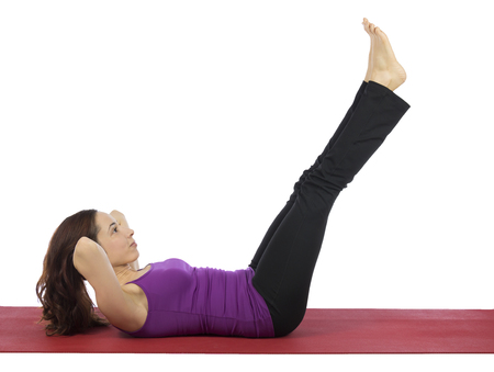 Young woman is doing crunch during fitness.