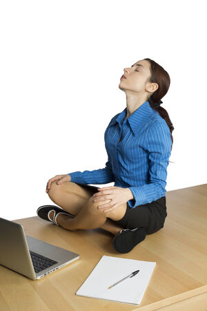 Young business woman is doing yoga to stretch her neck. photo