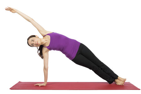 Woman is doing side plank pose in yoga