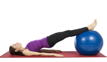 Young woman is doing fitness with pilates ball  Stock Photo