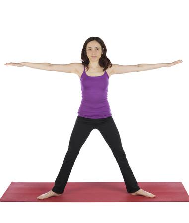 trikonasana: Young woman is doing Trikonasana pose in yoga  Stock Photo