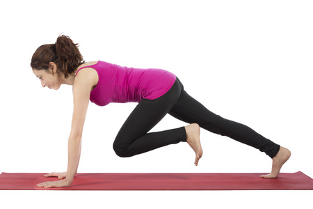 Young woman is doing mountain climber during fitness