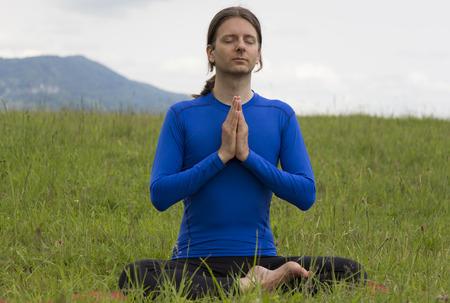 Man is meditating outdoors. photo