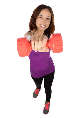 strengthening: Smiling young fitness woman is lifting weights.