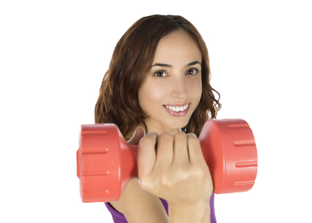 Fitness woman is holding a dumbbell. photo