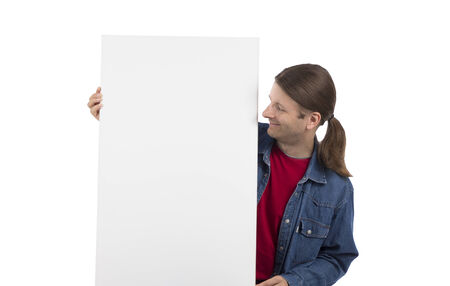 os: Smiling man os holding a white advertisement placard