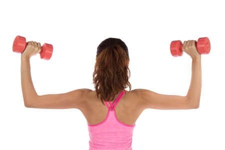 Fitness woman lifting weights photo