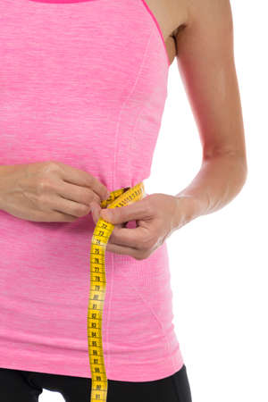Woman is measuring her belly photo