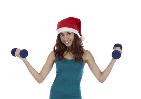 Christmas fitness woman lifting weights photo