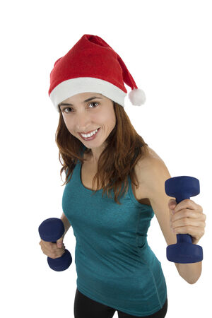 Christmas fitness woman with dumbbells photo