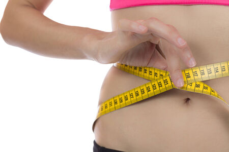 Weight loss woman with a measurement tape photo