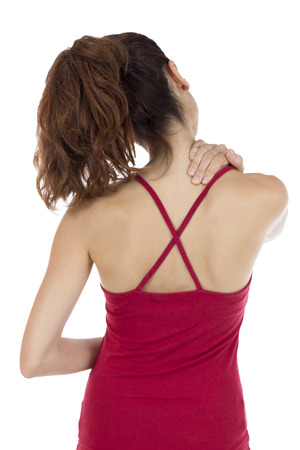 tense: Young woman touching her tense should and neck muscles