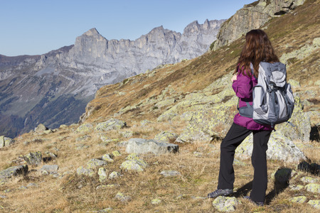 swiss alps: Woman hiking on Swiss Alps watching the mountain landscape