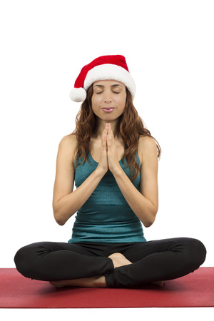 anjali: Attractive christmas woman in lotus pose meditating