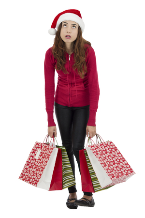 Christmas shopping woman carrying gift bags tired, isolated on white background photo