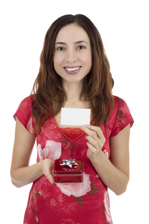 Valentines day woman with a gift box in her hand showing a gift card photo