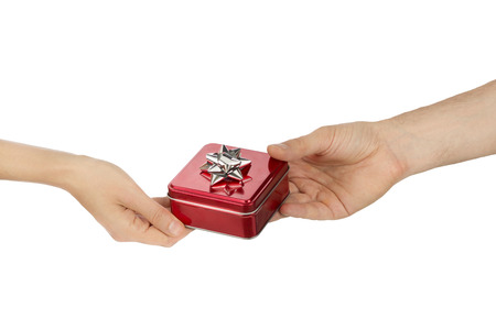 Male hand giving a red gift box to female hand, valentines day and love concept photo