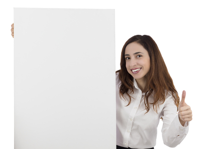 Business woman giving thumbs up and showing a blank poster photo