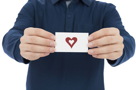 message card: Man showing a sign card with heart on for valentines day