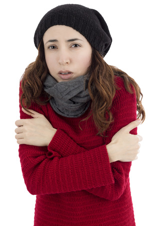 Woman shivering because of cold Standard-Bild