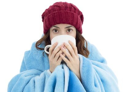 white person: Woman feeling cold and drinking warm tea