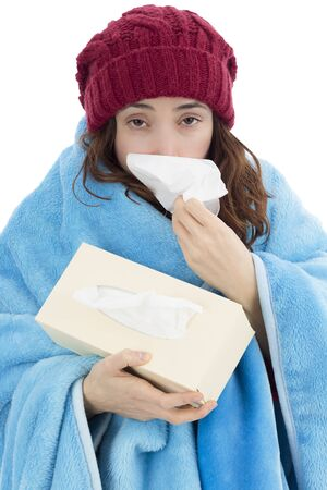 shivering: Shivering flu woman sneezing with a tissue