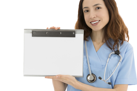 Female nurse or doctor holding a blank clipboard for advertisement photo