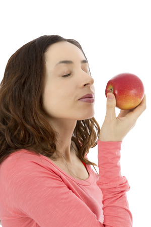 nourish: Woman holding delicious red apple