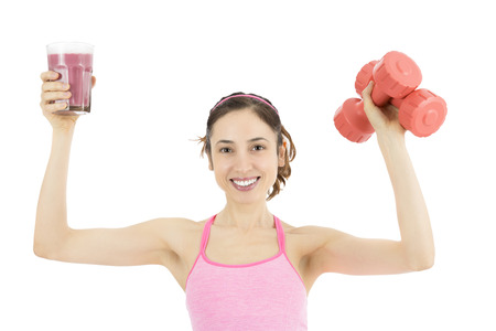 Active woman with dumbbells and a glass of smoothie photo