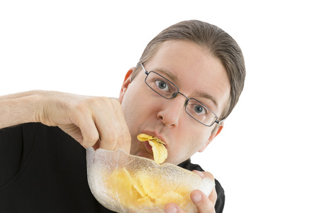 hurried: Caucasian man eating chips in a hurry