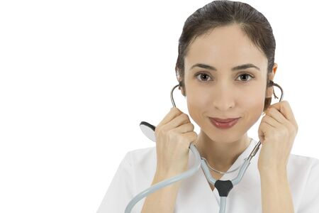 Female doctor listening with stethoscope photo