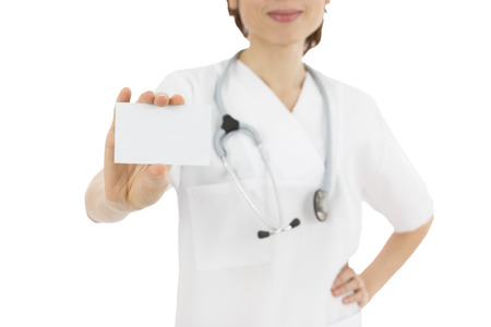 Female medical doctor showing sign card photo