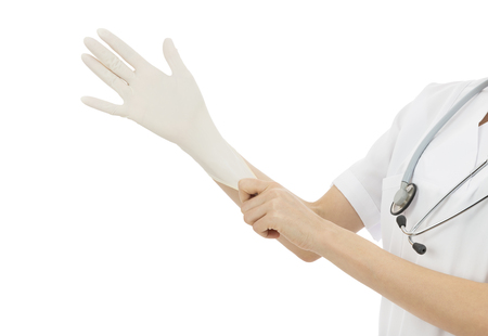 Medical doctor wearing surgical gloves photo