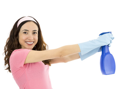 Woman cleaning with spray bottle Standard-Bild
